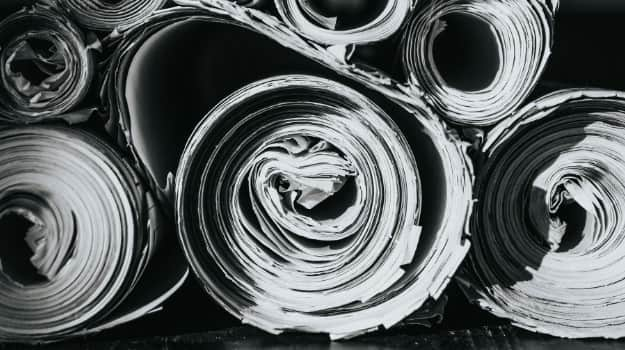 Rolls of newspaper (grey)