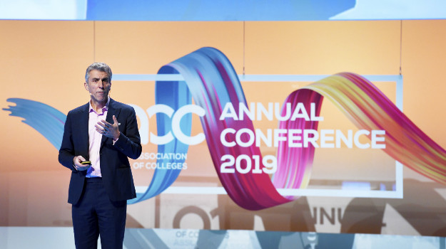 David Hughes on stage at AoC annual conference 2019